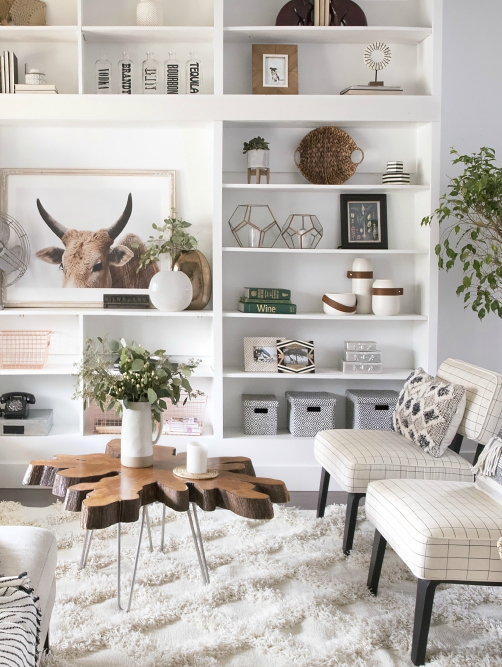 white living room with great shelves styling