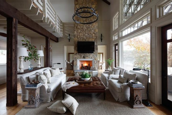 country formal high ceiling living room with stone fireplace