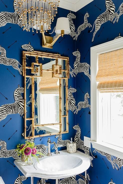 Amazing bathroom with white and blue wallpaper