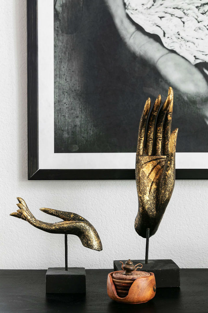 gold decorative hands sculptures