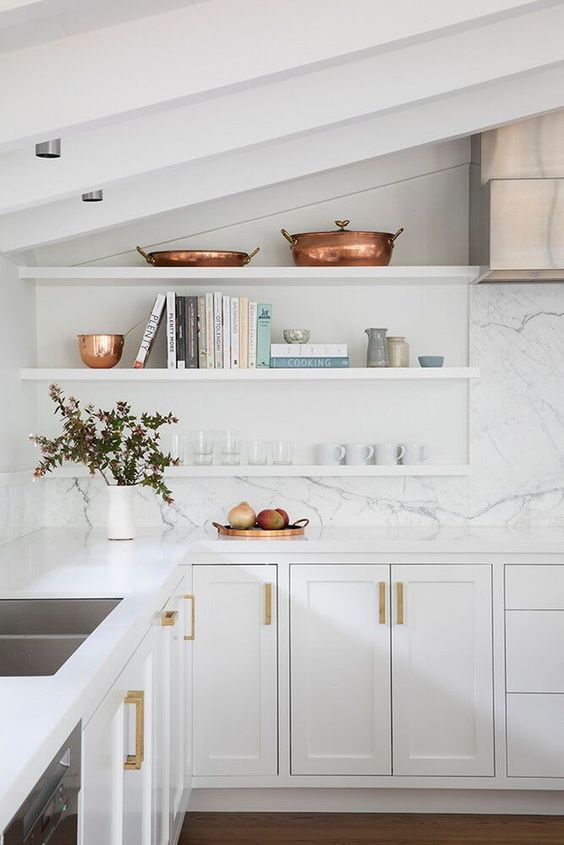 all white attic kitchen with marble backsplash and open shelves