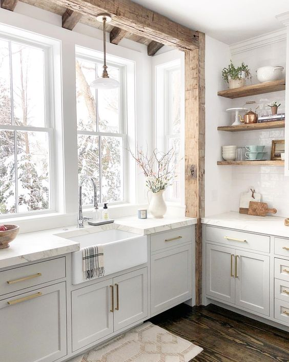 all white kitchen with reclaimed wood open shelves