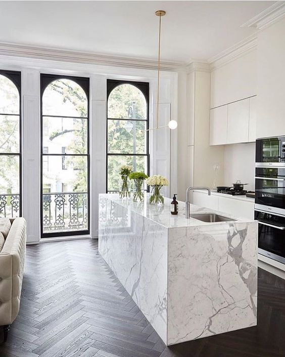 modern all white kitchen with marble island
