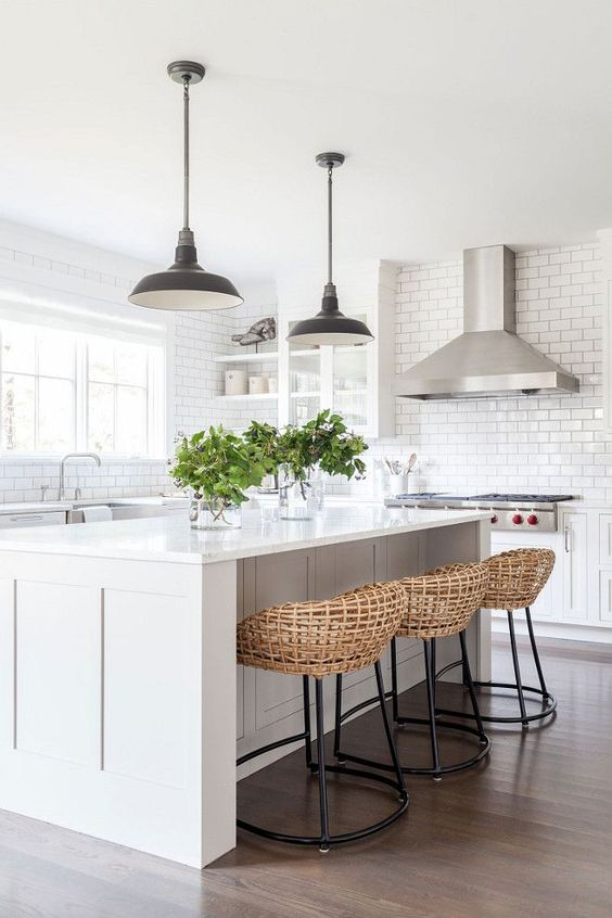 all white kitchen with rattan stools