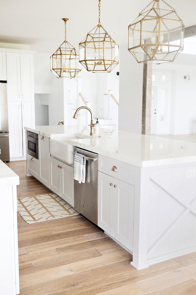 all white kitchen with gold lighting