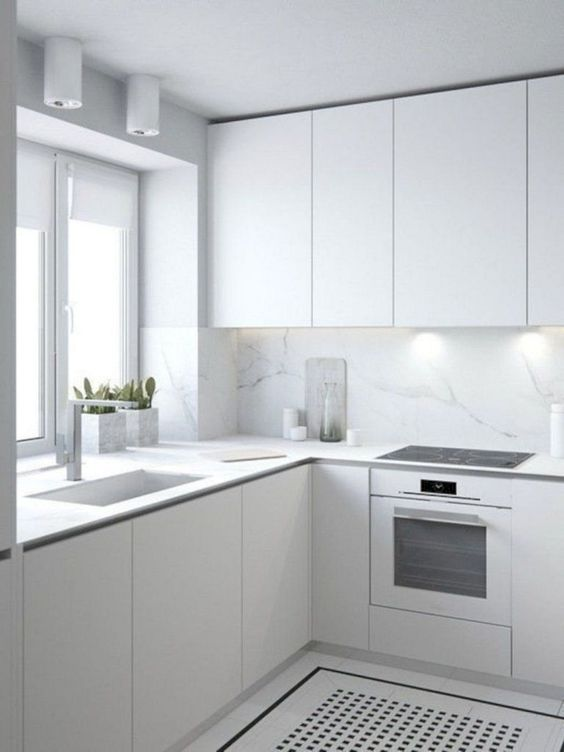 modern all white kitchen with marble backsplash