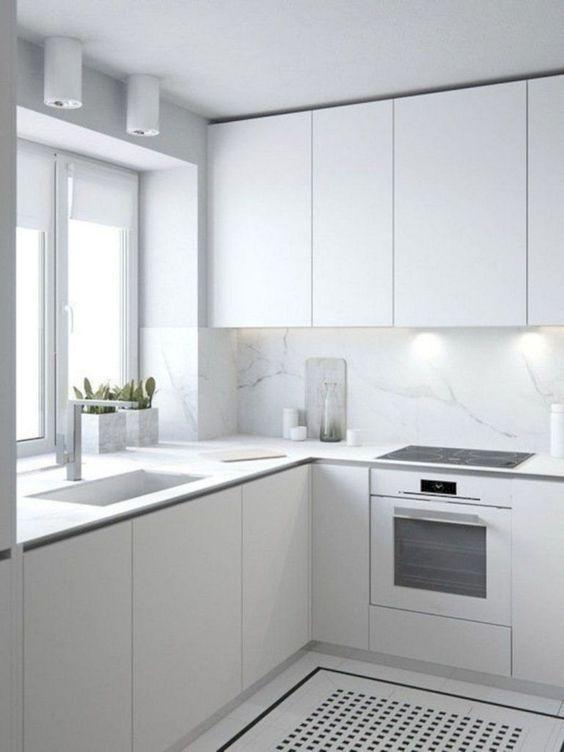 modern all white kitchen with marble backsplash