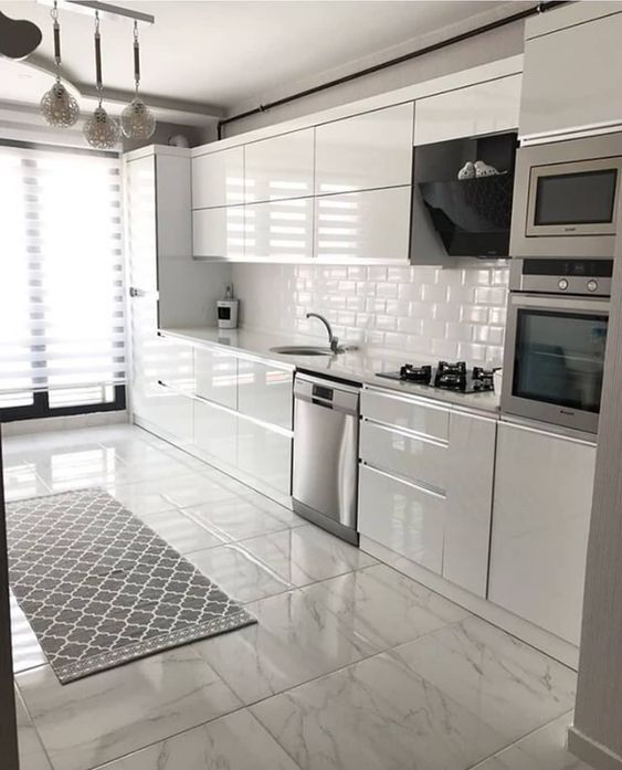 modern all white kitchen with metro tiles