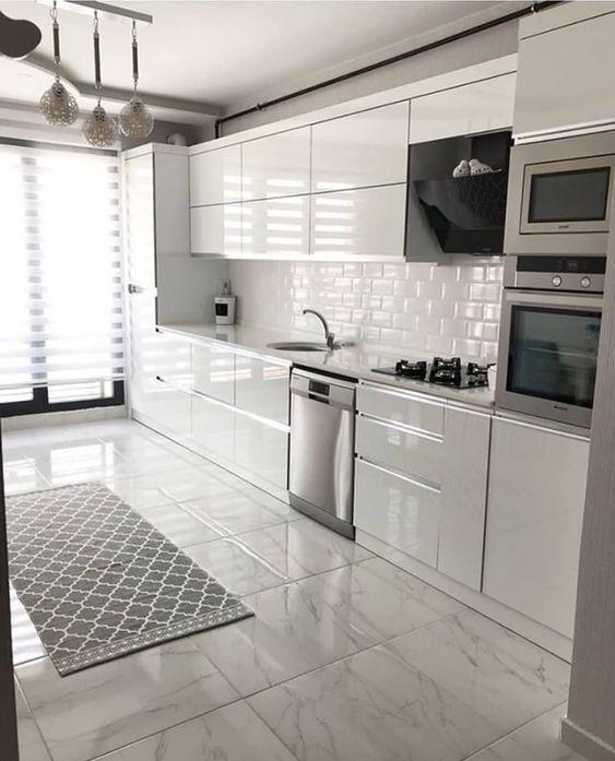 modern all white kitchen with metro tiles