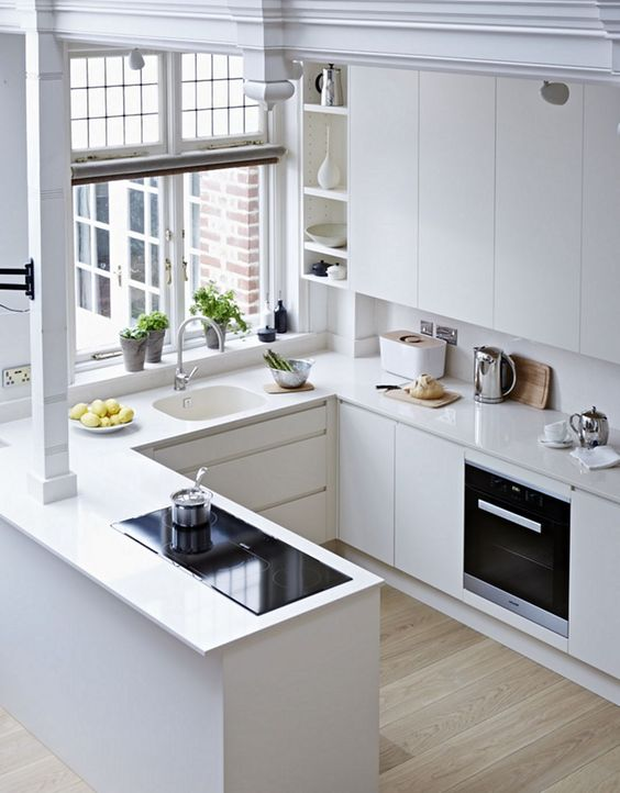 open plan all white kitchen with corian kitchen counter top