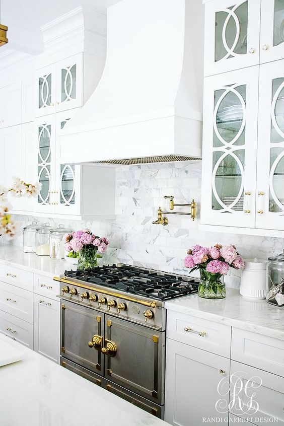 all white luxury kitchen with marble work top