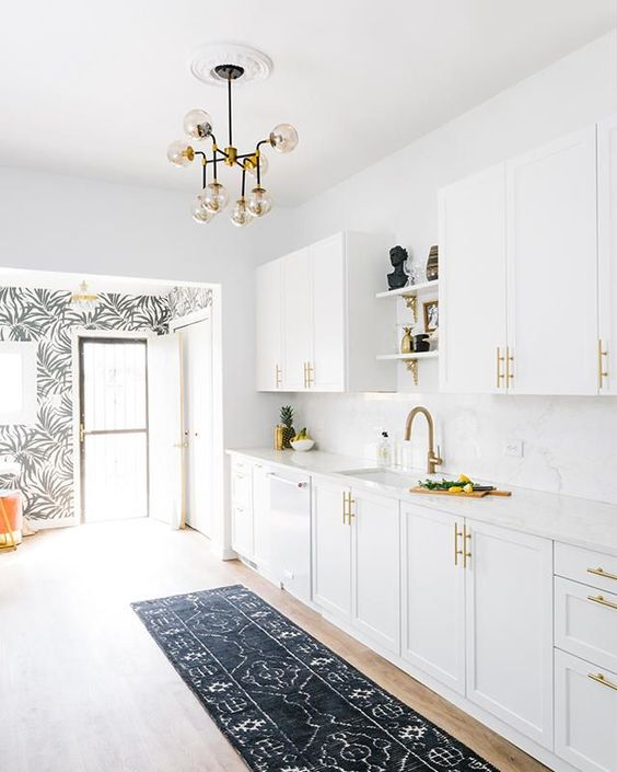 all white kitchen with gold touches