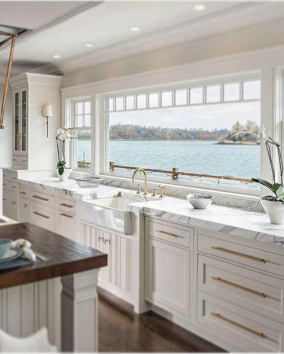 all white kitchen cabinets with modern gold handles