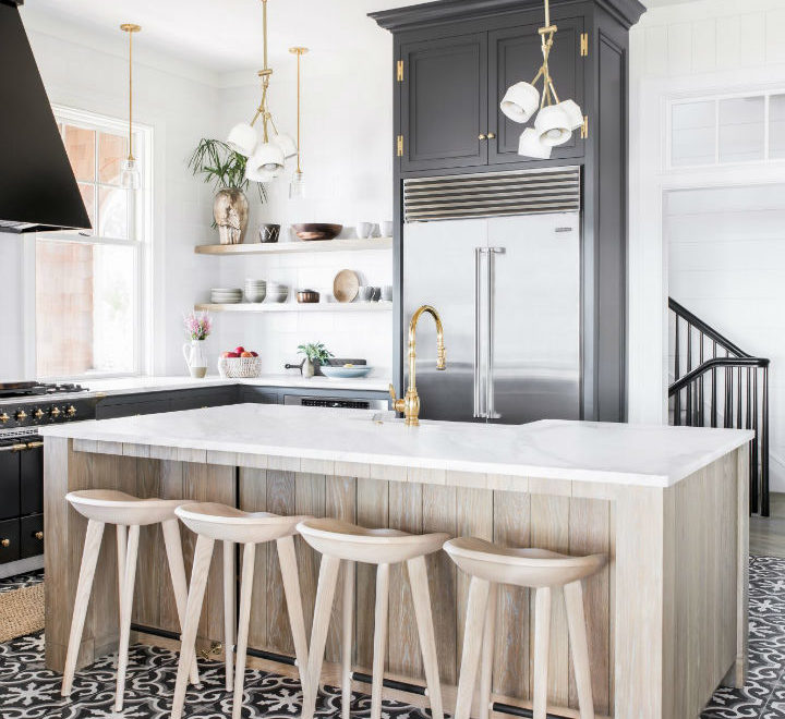 black and white kitchen with wood island and stools