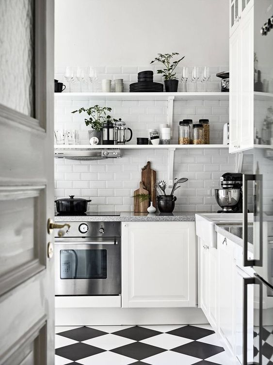White Scandinavian kitchen with black and white flooring