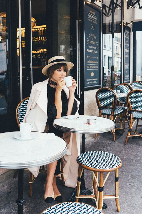 woman drinking coffee in a French Bistro
