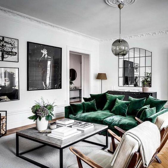 scandinavian home interior with velvet green sofa in a white living room