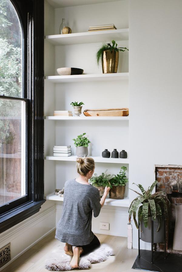 decorative shelves and a big window