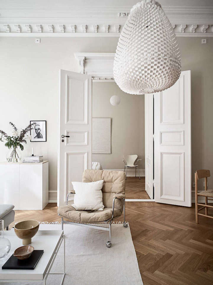white living room and a beige armchair