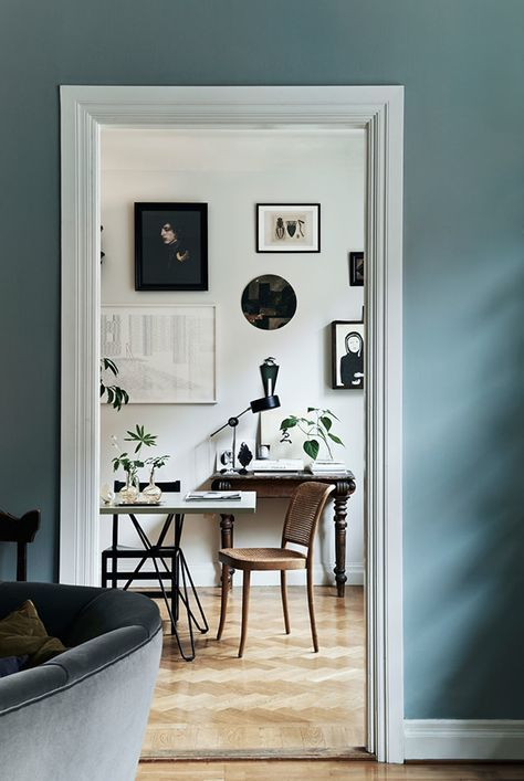 decor with photo frames and a desk with a lamp