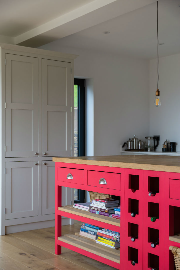 red cabinets in hardwood-framed kitchen