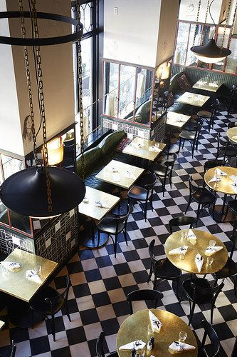 French bistro black and white flooring and small tables