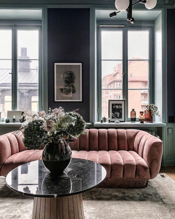Scandinavian style living room with dark grey walls and blush pink velvet sofa