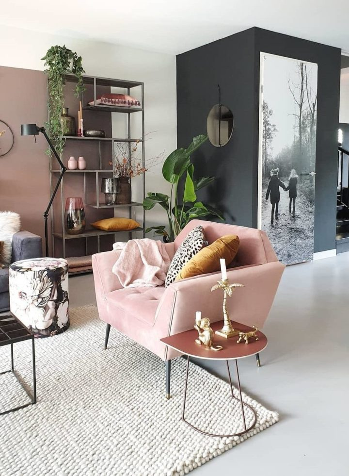 living room with blush pink and black wall