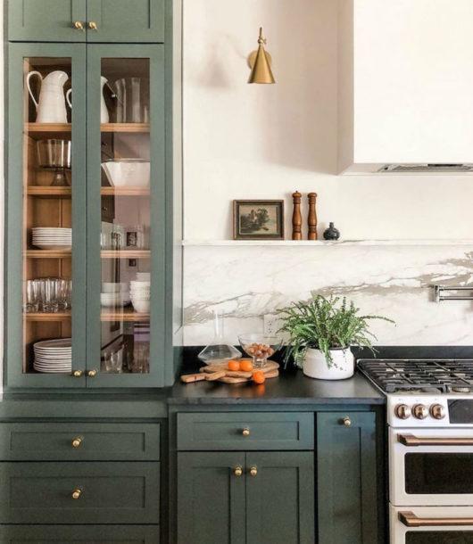 a green kitchen in a modern interior