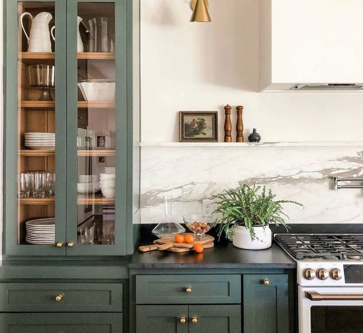 a green kitchen in a modern interior