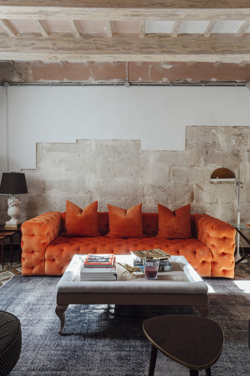 Living room with bold orange sofa