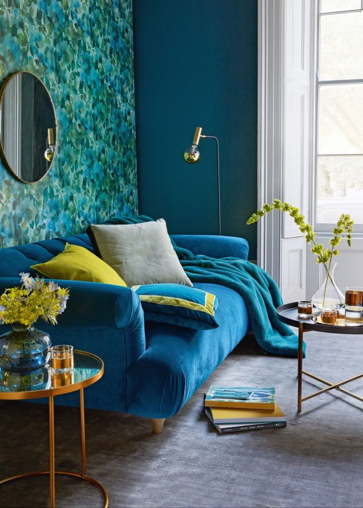 bold color blue sofa in a blue living room