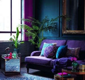 living room with violet purple sofa