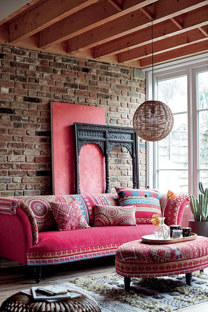 boho living room with pink sofa
