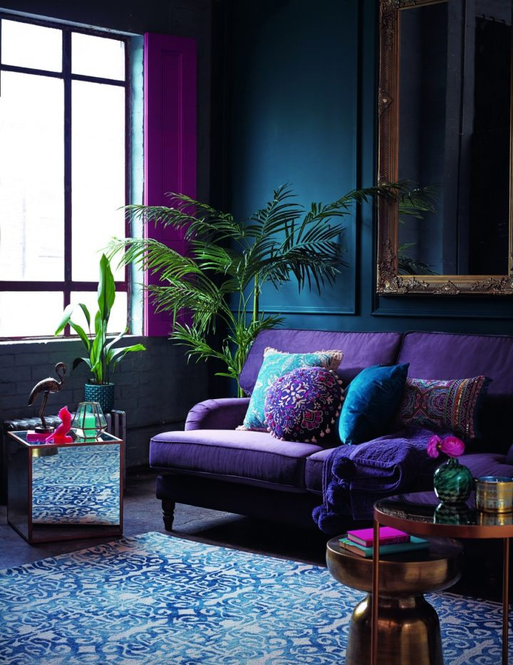 living room with violet purple bold color sofa