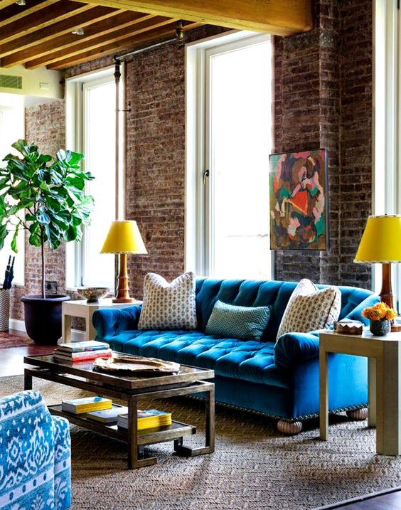 living room with blue velvet tufted sofa