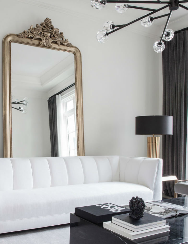 contemporary design with white sofa and a mirror