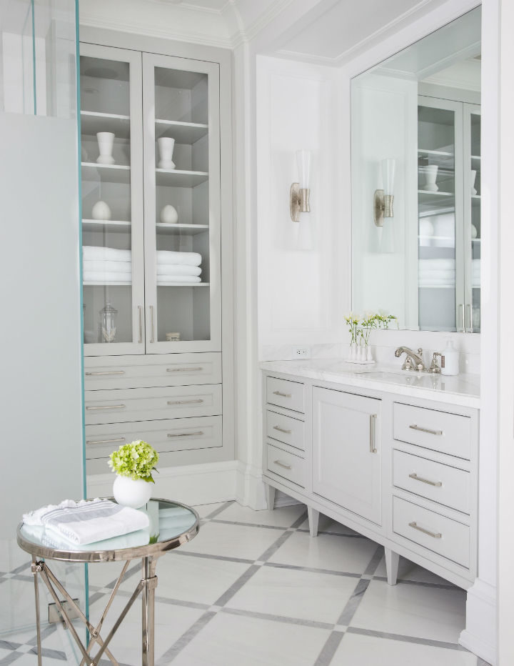 white cabinets and a mirror
