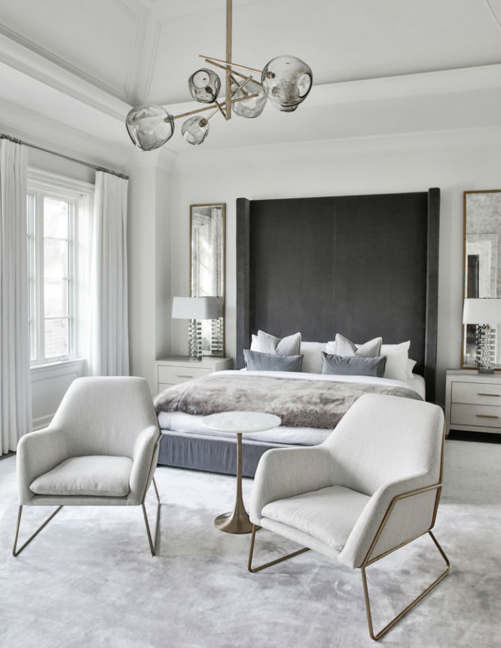 modern bedroom decor with white walls creating a contemporary design