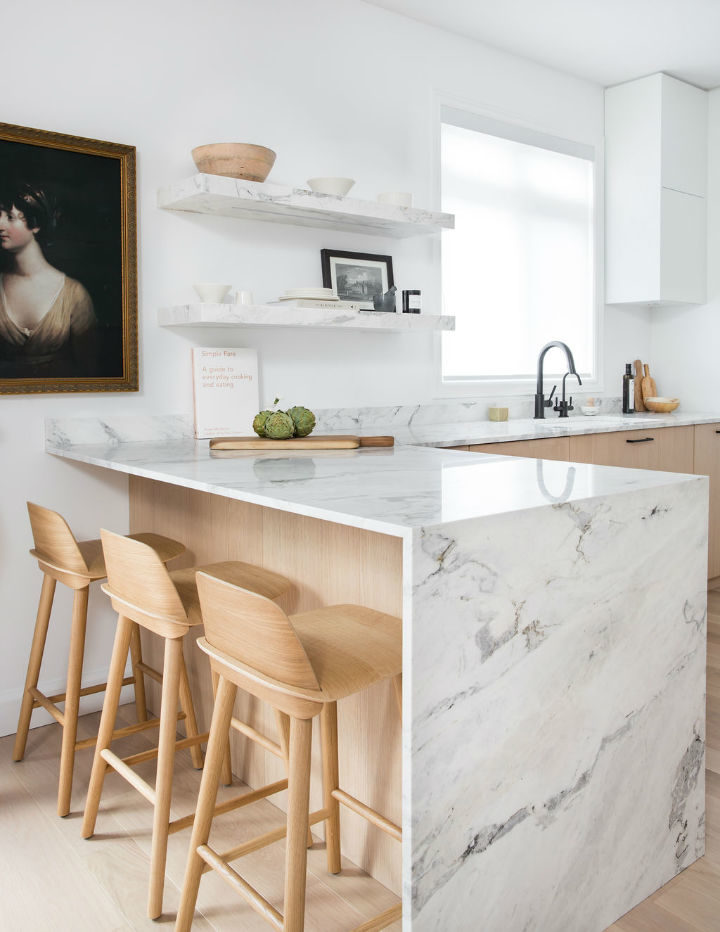 marble material used in kitchen with wooden chairs