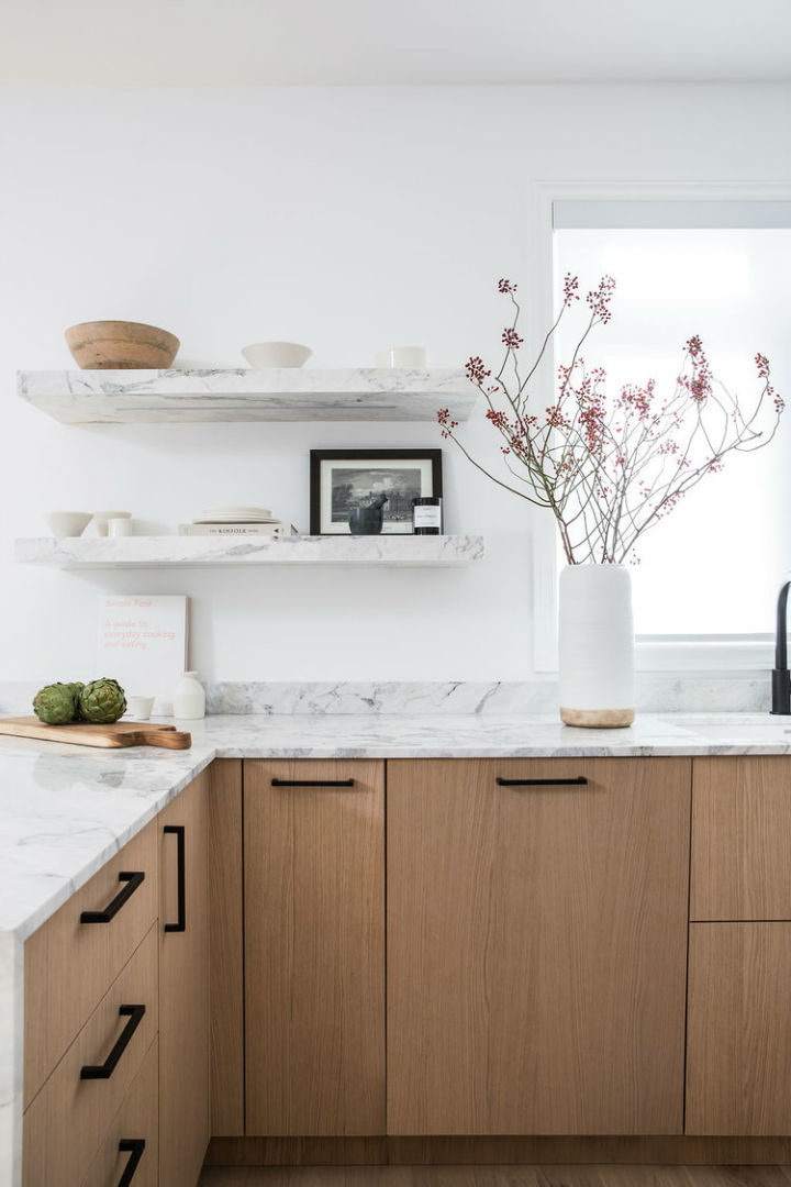 wooden cabinets with marble surface in a contemporary design