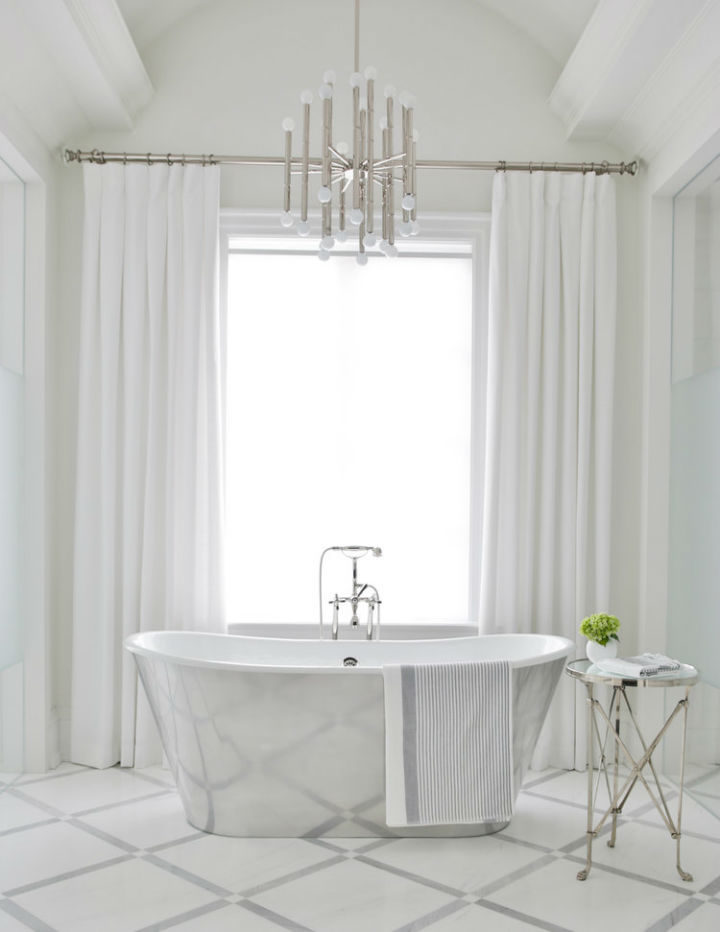 total white bathroom and a modern chandelier for a contemporary design