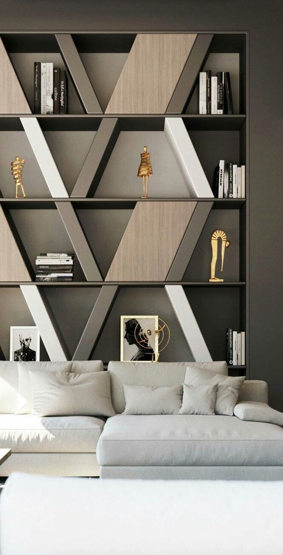 special masculine home design with a white sofa and a bookshelf