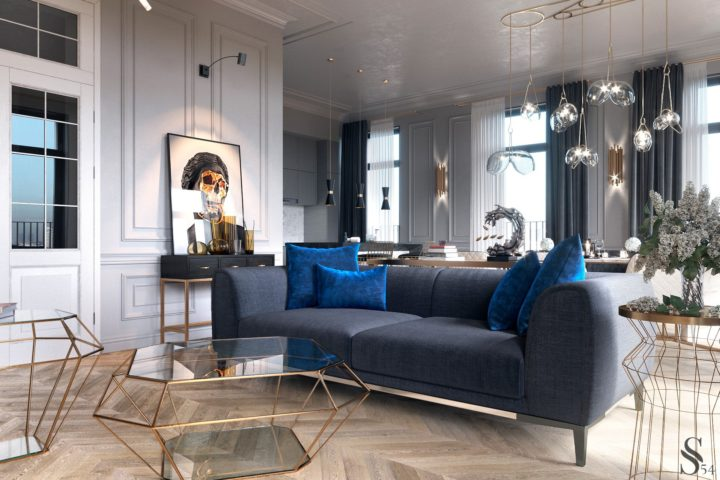 blue sofa and glass living room tables