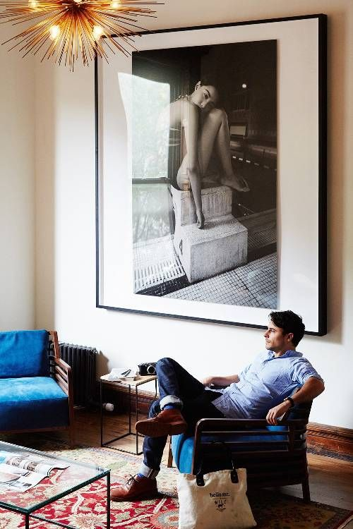 man sitting in his masculine apartment