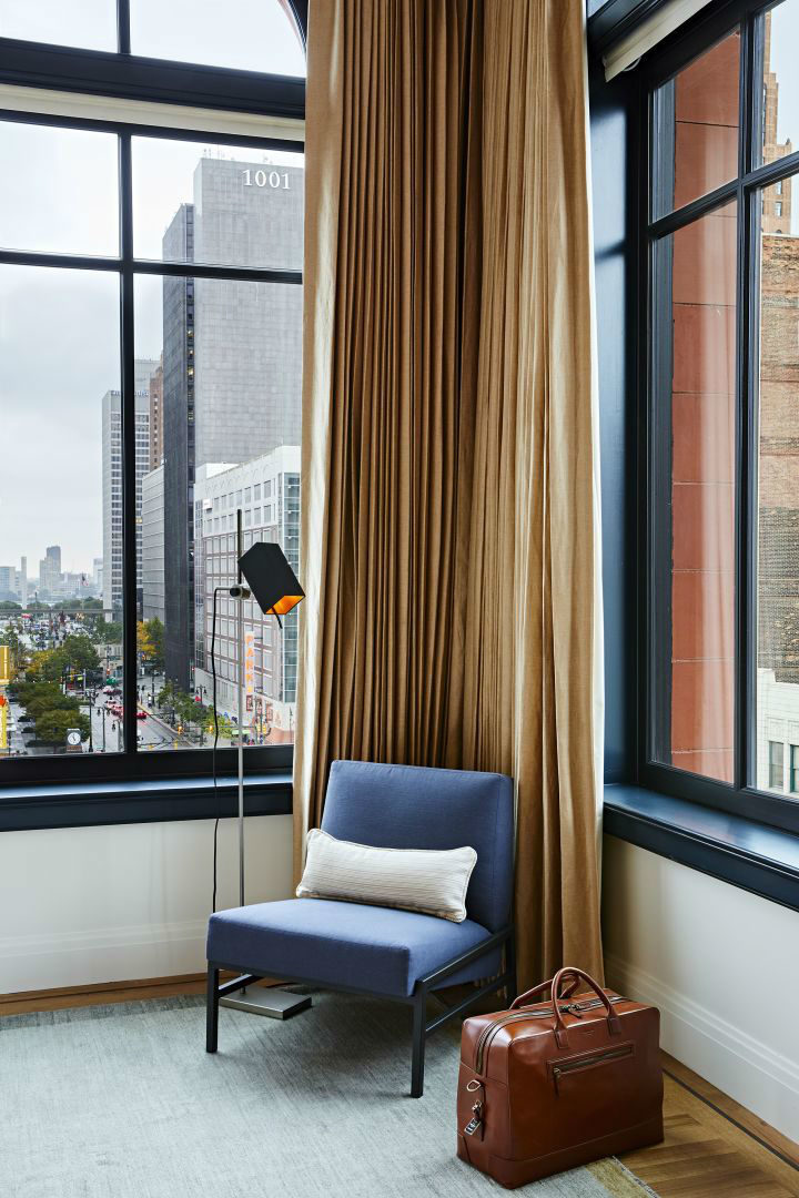 brown curtain with a blue armchair