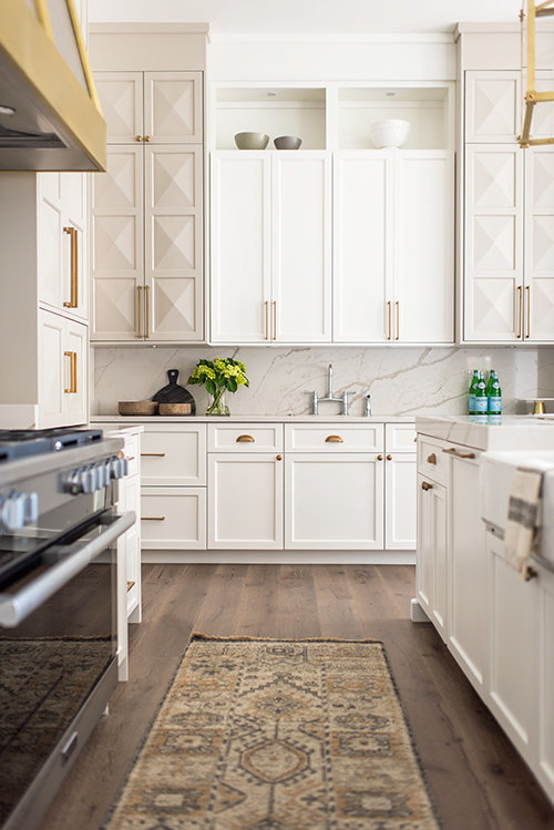 white cabinets and wooden flooring