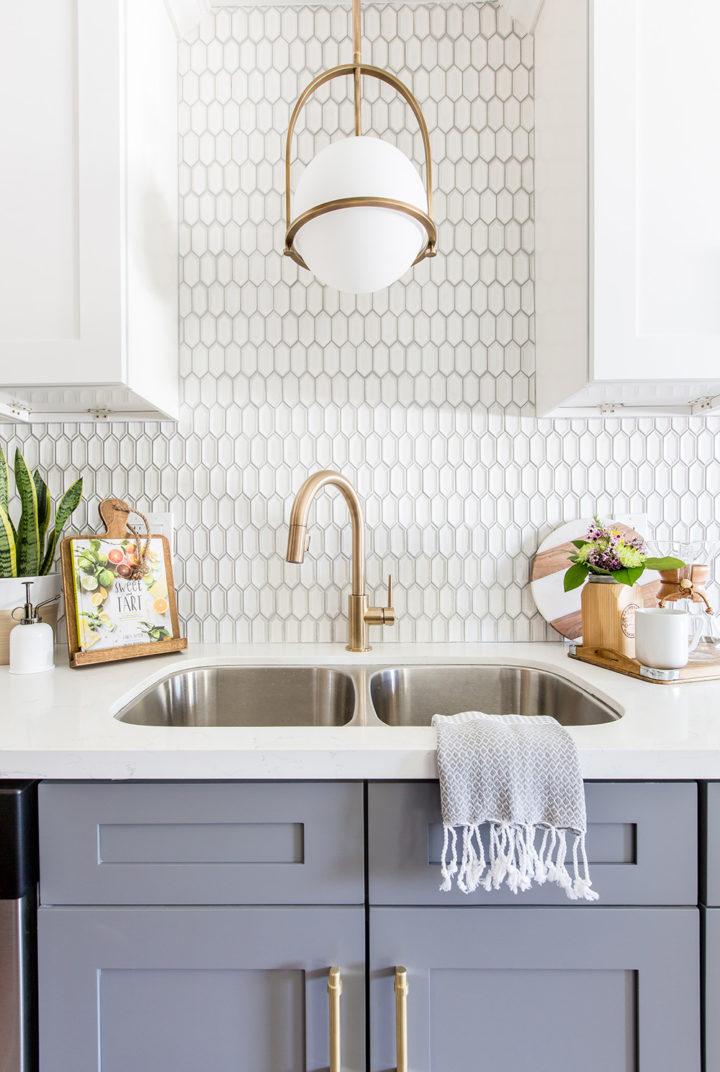 gray cabinet under a sink