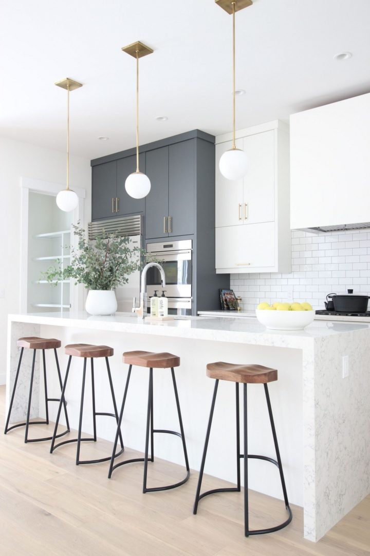 wooden stools and gray cabinets