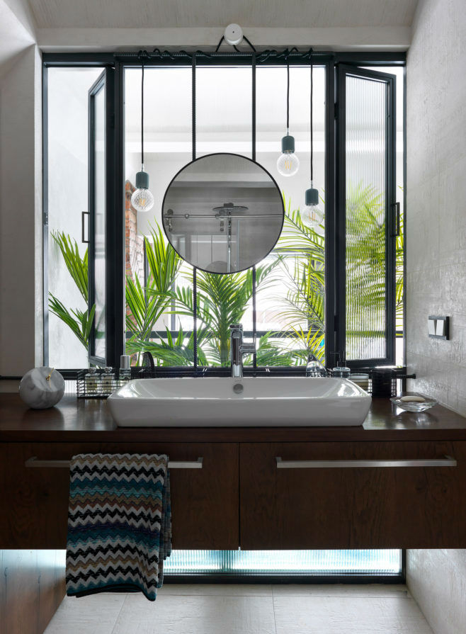 bathroom with large window above the bathroom sink